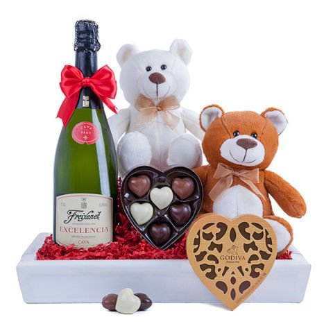 Chocolates, two teddies and sparkling wine