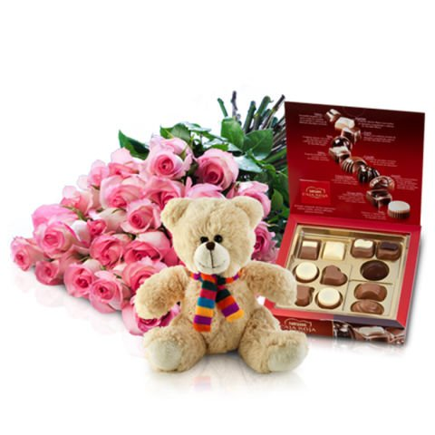 Sweet surprise: pink roses, chocolates and teddy bear