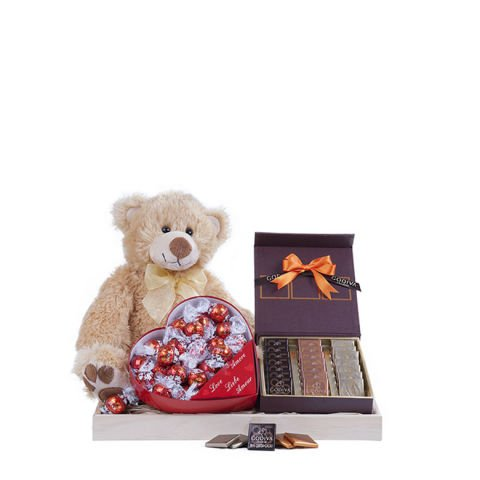 Love and chocolate basket with chocolates and a teddy bear